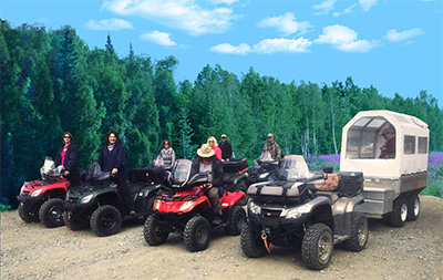 Guests ready to head out on all terrain vehicles and covered wagon